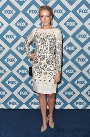 Jennifer Finnigan looked charming at the Fox All-Star party in a rose-patterned white cocktail dress.