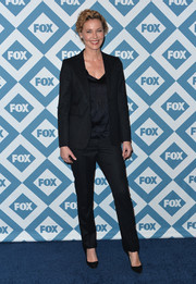 Connie Nielsen suited up in this navy pinstripe combo for the Fox All-Star party.
