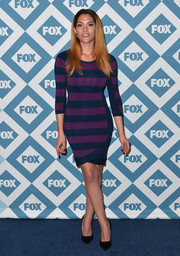 Inbar Lavi flaunted some enviable curves in a blue and purple striped sweater dress during the Fox All-Star party.
