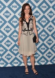 Mary Lynn Rajskub paired her dress with sexy black evening sandals.