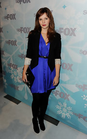 Amber Tamblyn paired her lovely look with a sleek black patent clutch.