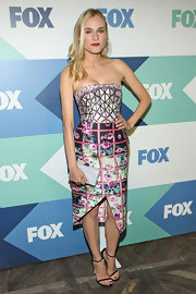 Diane Kruger stunned in her artsy meets sexy structured print dress.