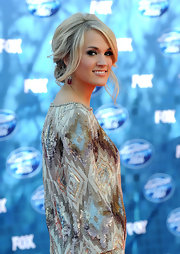 Carrie was ultra chic at the 'American Idol' finale with a simple updo with face framing layers.