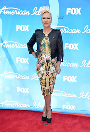 Emeli Sande chose a zipper-embellished black leather jacket for her red carpet look.