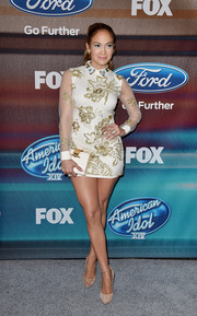 Jennifer Lopez went for a majorly leggy look during the 'American Idol XIV' finalist party in a Marchesa-notte micro-mini adorned with gold floral beading.