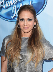 Jennifer Lopez styled her flowing locks into a half-up 'do for the 'American Idol XIV' red carpet event.