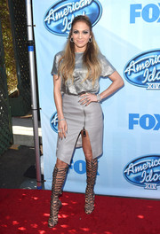 As if the metallic shirt and leather skirt weren't fab enough, Jennifer Lopez donned a killer pair of knee-high silver gladiator heels by Sophia Webster.