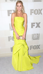 Julie Bowen added a playful touch to her neon look with this snakeskin printed frame clutch.