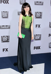 Zooey Deschanel played up her gown's green bodice with a glittery emerald clutch.