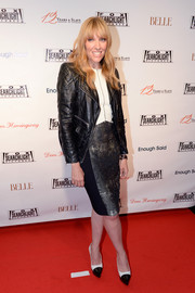 Toni Collette sported a black-and-white ensemble, consisting of cap-toe platform pumps, a sheath dress, and a leather jacket, at the Fox Searchlight TIFF party.