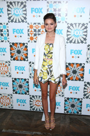 Ciara Bravo layered a white blazer over her crop-top/mini skirt combo for a smarter finish at the Fox Summer TCA All-Star Party.