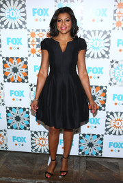 Taraji P. Henson paired her dress with simple yet elegant black ankle-strap sandals.