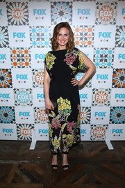 Emily Deschanel teamed her dress with on-trend black ankle-cuff sandals.