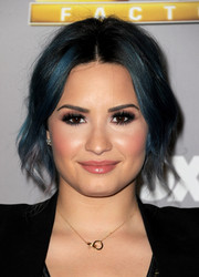 Demi Lovato's loose center-parted updo at the 'X Factor' season finale was a perfect blend of edgy and pretty.