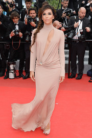 Eva Longoria flashed a bit of cleavage in a slashed nude turtleneck gown by Vionnet during the 'Foxcatcher' premiere.