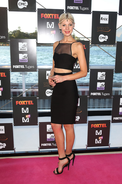 Kate Peck was on trend in a pair of minimalist black ankle-strap sandals.