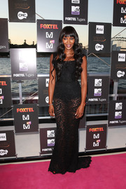 Naomi Campbell looked seductive on the pink carpet in a sheer black lace gown by Dolce & Gabbana during the Foxtel Music Channels summer launch.