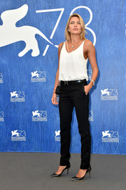 Tetyana Veryovkina opted for a simple white cami when she attended the Venice Film Festival photocall for 'Franca: Chaos and Creation.'
