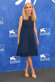 Franca Sozzani styled her frock with nude and gold T-strap sandals.