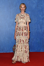 Lauren Santo Domingo arrived for the Venice Film Fest premiere of 'Franca: Chaos and Creation' wearing a nude gown with colorful embroidery.