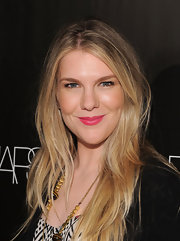 Lily Rabe amped up her look with a saturated application of bubblegum pink lipstick.
