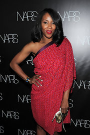 June Ambrose was carrying a gold zip-around wristlet at Francois Nars' book celebration.