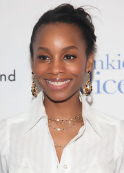 Anika Noni Rose paired her elegant bun with sparkling gemstone earrings. It was the perfect way to make her look standout.