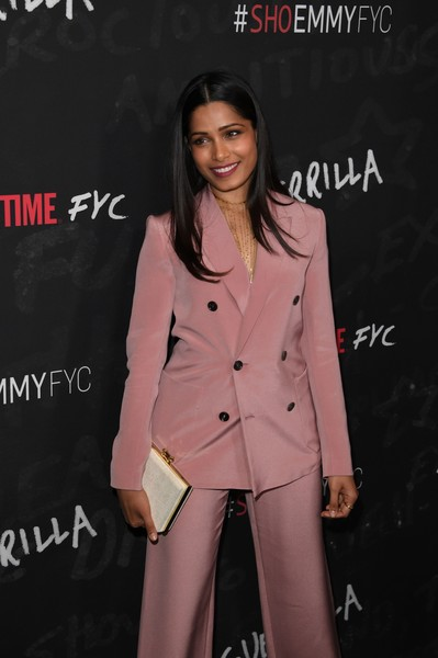 Freida Pinto Box Clutch [photo,clothing,suit,fashion,outerwear,pink,formal wear,coat,pantsuit,blazer,trench coat,freida pinto,mark ralston,guerrilla fyc,wga theater,showtime,guerrilla fyc,afp,red carpet,event]
