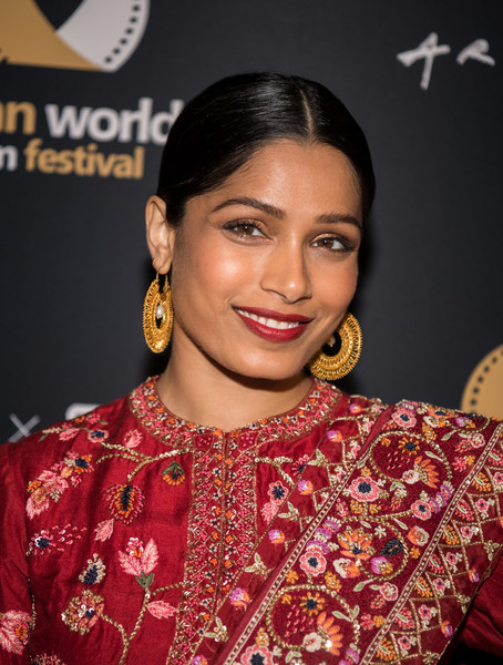 Freida Pinto Gold Hoops [opening night screening of ``love sonia,hair,hairstyle,eyebrow,lip,jewellery,eyelash,fashion accessory,event,makeover,black hair,arrivals,freida pinto,love sonia,arclight culver city,california,4th annual asian world film festival,4th annual asian world film festival opening night screening]
