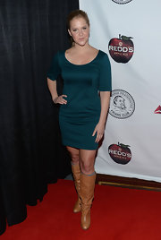 Amy Schumer chose a deep teal cocktail dress to wear to the Friars Club Roast of Jack Black.