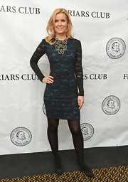 "Andrea Schroder looked edgy and cool in a blue and black lace cocktail dress, which she wore to The Friar's Club ""So You Think You Can Roast?"" event."