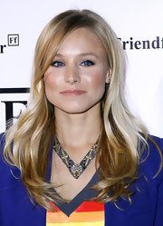 Kristin Bell attended a launch in new York wearing a purple-and-yellow gemstone necklace.