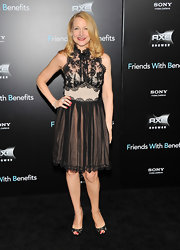 Patricia Clarkson looked lovely in a lace cocktail dress for the 'Friends with Benefits' premiere. The dress featured a mock-neck and scalloped edging. Patricia added a pop of color with red nails and lips.