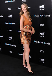 Julie Henderson kept the wow factor restrained to her asymmetrical orange frock at the 'Friends With Benefits,' choosing to finish off the look with a pair of classic black suede peep-toes.