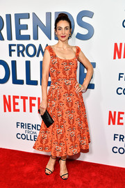 Annie Parisse channeled the '50s with this orange fit-and-flare print dress by Zac Posen at the New York premiere of 'Friends from College.'