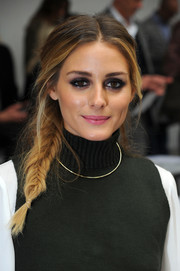 Olivia Palermo contrasted her bold eye makeup with a soft pink lip.