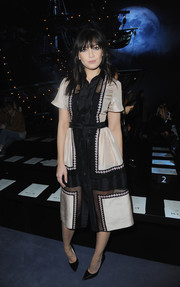 Daisy Lowe was classic and cute in a two-tone mesh-panel shirtdress while attending the Temperley London fashion show.
