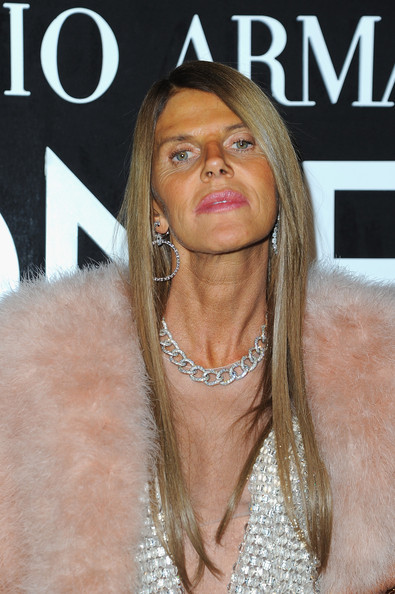 Anna dello Russo loaded up on the bling, pairing a diamond chain necklace with a pair of dangling hoops.