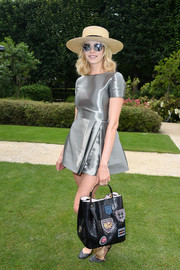 Elena Perminova donned a futuristic-meets-fun silver mini for the Dior Couture fashion show.