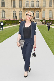 Evelina Khromtchenko was sporty-chic in a navy pantsuit during the Dior Couture fashion show.