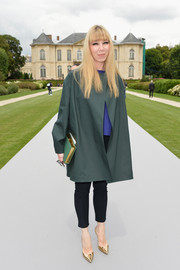 Mathilde Meyer teamed a boxy teal coat with black skinnies for the Dior Couture fashion show.