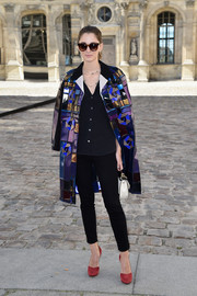 Sofia Sanchez Barrenechea teamed her chic coat with black skinny pants and a button-down shirt.