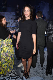Julia Restoin-Roitfeld styled her dress with strappy black platform sandals by Prada.
