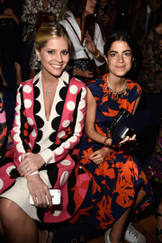 Leandra Medine attended the Valentino fashion show looking ladylike (well, except for those sneakers) in a lovely floral dress.