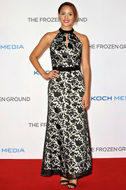 Nathalie stuck to a classically elegant red carpet look when she donned this black-and-white, patterned halter neck dress.