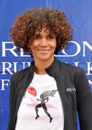 Halle Berry wore her luxe mane of curls casually tousled while attending the Revlon Run/Walk for Women.