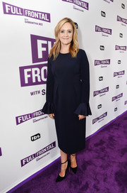 Samantha Bee kept it classy in a tea-length navy dress with ruffle cuffs at the 'Full Frontal' FYC event.