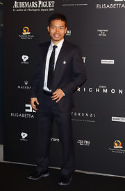 Yuto Nagatomo looked sharp and sophisticated in a formal black pinstripe suit at the Fundaction Privada Samual Eto'o charity event.