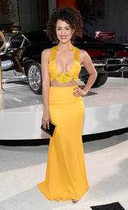 Nathalie Emmanuel sent hearts racing with this cleavage-and-abs-baring yellow cutout gown by Cushnie et Ochs at the 'Furious 7' LA premiere.