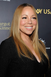 Mariah Carey left her long hair loose in a pin-straight style when she attended the G'Day USA Black Tie Gala.
